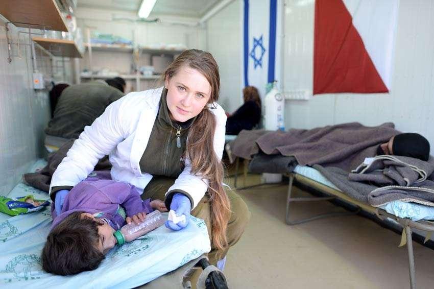 IDF medic treats injured Syrian girl field hospital