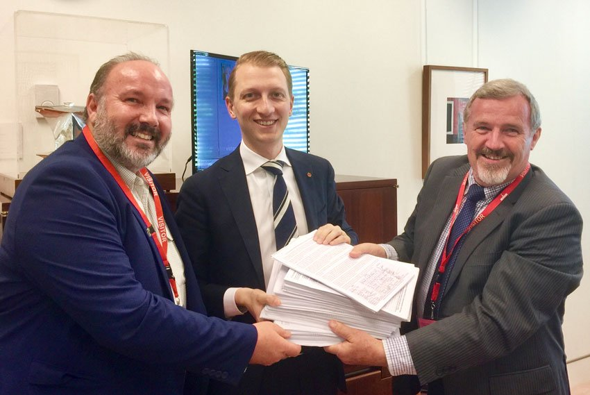 Photo left to right: Ian Worby, Sen. James Paterson and Keith Buxton. Ian and Keith presenting the 8000+ signatures to Sen. Paterson
